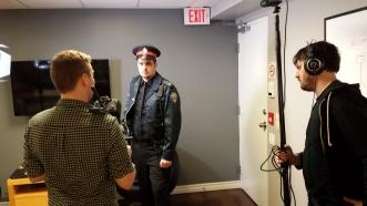 Justin Greig (The Cop)